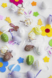 Easter eggs, bunnies, flowers ,  paper chickens decorations on w Royalty Free Stock Images