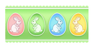 Easter eggs with bunnies on green background Royalty Free Stock Image