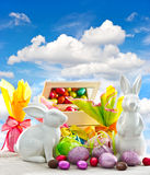 Easter eggs and bunnies over blue spring sky Stock Photos