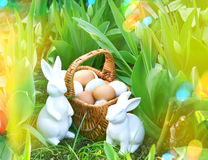 Easter eggs and bunnies with spring tulip flowers. Sunny day Stock Photo