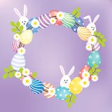 Easter eggs and bunnies wreath. A wreath decorated with eggs, flowers, leaves and bunnies Royalty Free Stock Photo