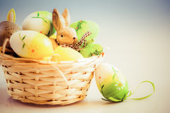 Easter eggs and bunny in basket Stock Photo