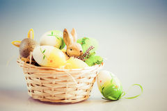 Easter eggs and bunny in basket Royalty Free Stock Photos