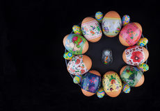 Easter eggs and bunny on black plate Royalty Free Stock Images
