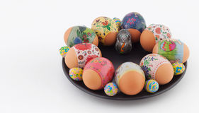 Easter eggs and bunny on black plate Stock Image