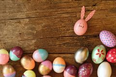 Easter eggs with bunny ear on wooden table. Happy and fun Easter concept. Copy space. Easter eggs with bunny ear on wooden table. Happy and fun Easter concept stock photos