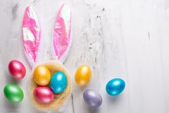 Easter eggs with bunny ears on a marble background. Lay lay with space for design. Horizontal composition. Greeting card concept stock photography