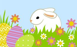 Easter eggs and bunny. In grass on blue background Stock Image