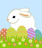 Easter eggs and bunny. In grass on blue background Royalty Free Stock Photos
