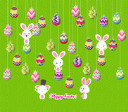 Easter eggs and bunny funny hanging on the wire Royalty Free Stock Image