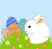Easter eggs and bunny. In grass on blue background Royalty Free Stock Photography