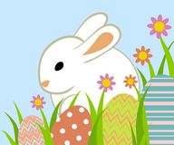 Easter eggs and bunny. In grass on blue background Royalty Free Stock Photo