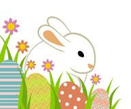 Easter eggs and bunny. In grass isolated on white Royalty Free Stock Images