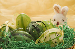 Easter eggs with bunny puppet near Royalty Free Stock Photos