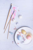 Easter eggs, bunny or rabbit ears. Pastel colors spring holiday decoration. Top view, copy space. Royalty Free Stock Photography