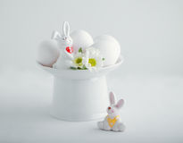Easter Eggs and  Bunny. Easter symbols - Eggs and Bunny on a white table Stock Photos