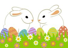 Easter eggs and bunny. Easter eggs and two rabbits in grass isolated on white Stock Photos