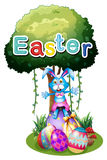 Easter eggs and a bunny under the tree Royalty Free Stock Images