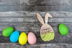 Easter eggs and bunny on wooden background. royalty free stock images
