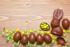 Easter eggs and  bunny on wooden background. Stock Image