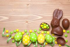Easter eggs and bunny on wooden background. Stock Photo