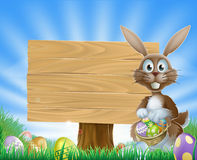 Easter eggs bunny and wooden sign Stock Photography