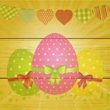 Easter eggs and bunting on wooden background Stock Photography