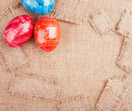 Easter Eggs on the Burlap Background Stock Image