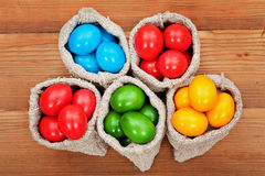 Easter eggs in burlap bags Royalty Free Stock Photography