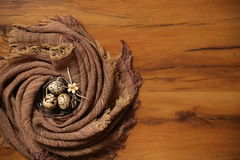 Easter eggs on burlap fabric and wood texture Royalty Free Stock Photo