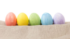 Easter eggs on burlap in a row Stock Photography