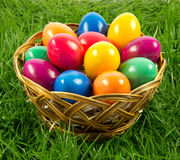 Easter eggs in busket on green gras isolated concept holyday postcard. Easter eggs in busket on green gras isolated concept holyday creative colourful work Royalty Free Stock Photography