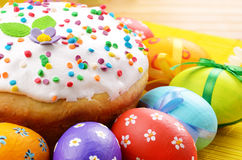 Easter eggs and cake Stock Images