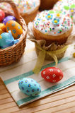 Easter eggs, cake, basket Stock Images