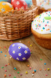 Easter eggs, cake, basket Stock Photo