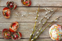 Easter eggs, cake and willow twigs on wooden table Stock Image