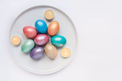 Easter eggs and candles Royalty Free Stock Images