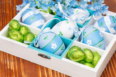 Easter eggs and candy in the box. Stock Image