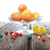 Easter eggs, candy and chicken Royalty Free Stock Photos