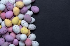 Easter eggs candy coloured on black background royalty free stock photos