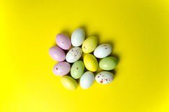 Easter eggs candy at yellow Stock Images