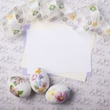 Easter eggs card. Easter eggs photographed on colorful paper with little white card royalty free stock photography