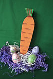 Easter eggs and carrot box Stock Photography