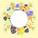 Easter eggs and carrots pattern on a yellow Royalty Free Stock Photos