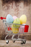 Easter eggs in the cart. Spring discount card. Royalty Free Stock Photography