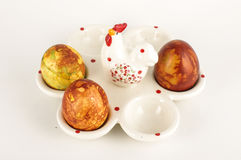 Easter eggs case with three painter traditional eggs on the bright background Royalty Free Stock Images