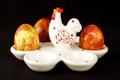 Easter eggs case with three painter traditional eggs low angle Royalty Free Stock Images