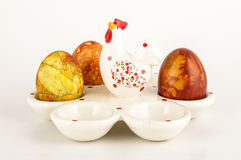Easter eggs case and three painter traditional eggs low angle Royalty Free Stock Images