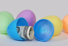Easter Eggs with Cash Inside. Colorful Easter eggs with cash hidden inside Stock Images