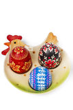 Easter eggs on ceramic plate. Chicken shape Stock Image